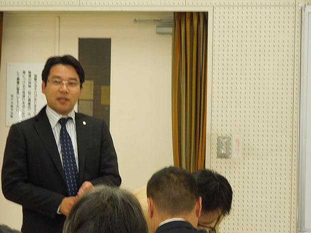 岩切企画部会長の講師紹介